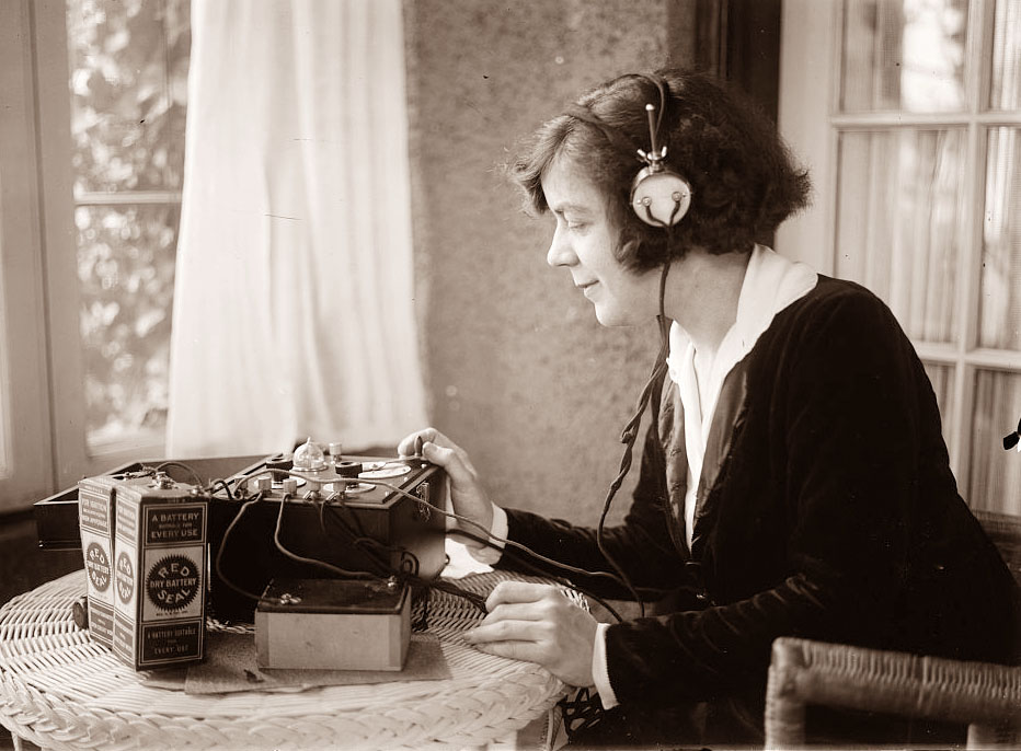 Vintage photograph of women with headset listening to a recording